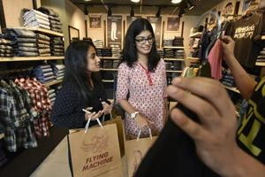Students Rhythem Vatsa (left) and Amrita Sokhi may be style conscious, but only spend money on big labels when quality is on offer.