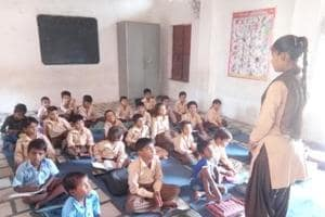 Class 7 student Madhu Kumar teaches primary classes in government-run school on Saturday in Bharatpur.