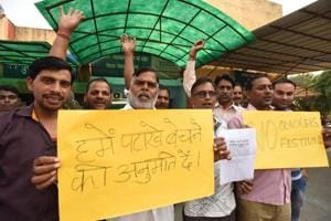 Fire cracker retailers protest against the Supreme Court decision to ban the sale of fire crackers, at the City Magistrate office in Noida on Monday, October 9, 2017