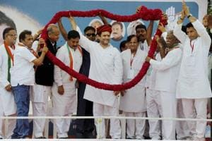 Congress workers felicitate party vice president Rahul Gandhi during a public meeting at Khatraj village of Kheda district in Gujarat on Monday.