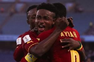 Sadiq Ibrahim of Ghana celebrates with teammates after scoring against Colombia in their FIFAU-17 World Cup opening game in New Delhi.
