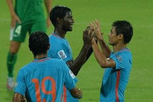 Rowllin Borges of Indian national football team (C) celebrates with teammates after scoring the opening goal in their AFC Asian Cup qualifier football match vs Macau at the Sree Kanteerava Stadium in Bangalore on Wednesday. Get final football score and highlights of the India vs Macau match here