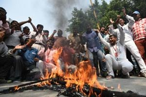 Employees of East Delhi Municipal Corporation protest at Patparganj  on Wednesday.