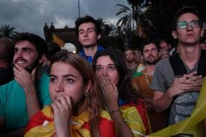 Supporters of an independence for Catalonia listen to Catalan president Carles Puigdemont