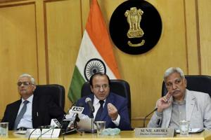Chief Election Commissioner A K Joti, flanked by, Election Commissioners Sunil Arora and O P Rawat (L) announces the schedule for the Himachal Pradesh Assembly elections, at a press conference in New Delhi on Thursday.