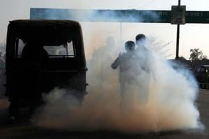 A Deisel auto rickshaw emitting smoke at Birsa Munda Rajpath in Ranchi