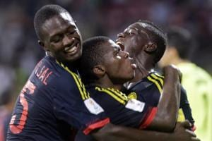 Colombia national football team player Deiber Caicedo (C) celebrates with teammates after scoring against USAnational football team in their FIFAU-17 World Cup football match at DYPatel Stadium in Navi Mumbai on Thursday.
