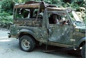 An army vehicle that was ambushed on the Pengeri-Digboi road near the Pengeri reserve forest in Assam