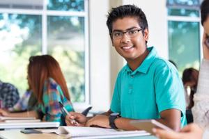 Indian student taking exam in high school or college class
