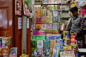 A shopkeeper waits for customers at his firecracker shop in New Delhi on October 9.