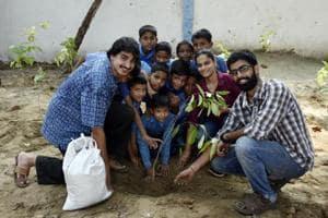 Sarthak Anand, Ashika Srivastava and Ashim Berry helping children plan a 'mini forest' at a Delhi school.