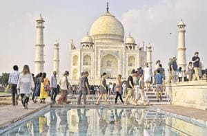 Tourists at the Taj Mahal, a UNESCO world heritage site. One of the most popular tourist draws in the country, India is often identified as the 'land of the Taj'.