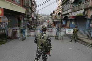 Paramilitary forces stand guard at the main market area during the 83th day of an indefinite strike called by the Gorkha Janmukti Morcha (GJM) for separate state Gorkhaland in Kalimpong on September 3, 2017.