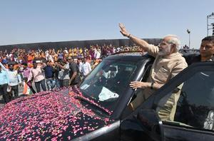Prime Minister Narendra Modi greets people during a public rally at Vadnagar in Gujarat recently.