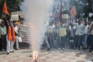 Activists protest against a court-ordered ban on the sale of firecrackers to curtail air pollution in the Delhi by setting off firecrackers during the protest.