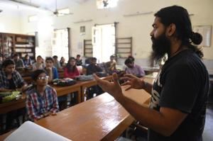 Students at Hindu College listen during a workshop on awareness of air pollution organised by New Delhi Nature Society on Friday.