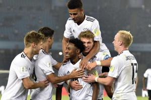 New Delhi, India - Oct. 16, 2017: John Yeboah (center) of Germany with team members celebrate3rd goal against Colombia during the U-17 World Cup Match at Jawaharlal Nehru Stadium in New Delhi, India, on Monday, October 16, 2017. (Photo by Mohd Zakir/ Hindustan Times)