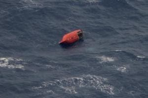 Search on for 11 Indian crew members after cargo ship capsizes off...