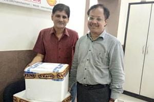 Divya mother milk bank staff and Devendra Jain (right) taking 48 units of mother milk in ice pack to Ahmedabad.
