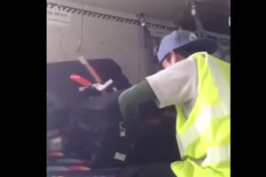 Watch | Baggage handler caught on camera stealing from passenger's bag...