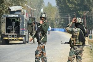 Paramilitary troopers stand guard after a gunfight with militants at Hajin village of Kashmir