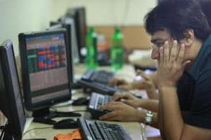 Stock market: Sensex drops 100 points on muted earnings,...