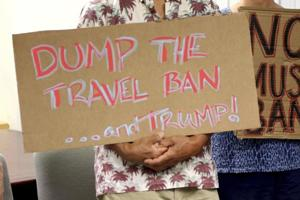 Judge blocks latest Trump travel ban, says it 'suffers from the same...