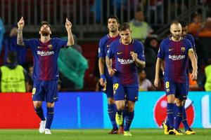 Lionel Messi joins 100-goal club as Barcelona beat Olympiakos in...