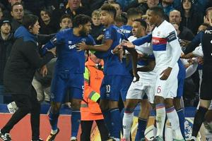 Everton ban fan who attacked Lyon player while holding child in Europa...