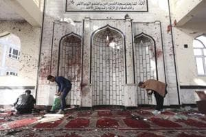 'Smell of blood and flesh' in Kabul Shia mosque hit by suicide bomber