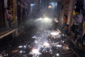 People burning crackers on the occasion of Diwali in New Delhi on October 19.