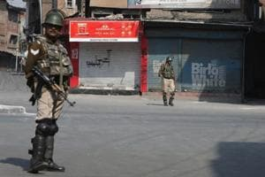 Paramilitary soldiers stands guard during restrictions in downtown Srinagar on Saturday. Authorities imposed restrictions in parts of downtown Srinagar as separatists had called for a shutdown against braid chopping incidents in Kashmir. So far, 100 incidents of braid chopping have cropped.