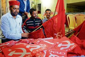 Communist Party of India (Marxist) workers arrange their party flags ahead of the assembly polls at the party office in Shimla on Saturday. Left parties, with a presence in some pockets of Himachal, have failed to leave a mark in the state politics.