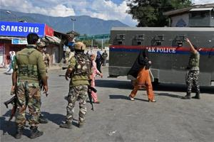 Security personnel at the scene of a grenade blast at Tral in Kashmir.