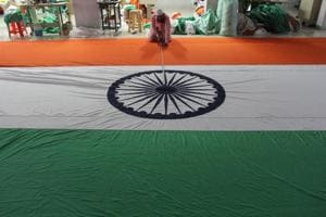 Workers in a flag factory at Bhiwandi  give final touches to the tricolour.