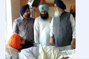 Former chief minister Parkash Singh Badal meeting Parminder Singh Kolianwali, son of SAD Muktsar district president and SGPC member Dyal Singh Kolianwali in Bathinda on Monday. Parminder was attacked in Malout on Sunday evening.
