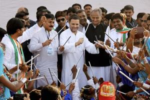 Congress vice president Rahul Gandhi participates in a cultural dance during a public meeting in Gandhinagar on Monday.