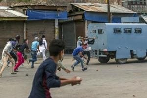File photo of Kashmiri protesters throwing rocks and bricks at an armoured vehicle belonging to paramilitary soldiers during a protest in Srinagar. Dineshwar Sharma was chosen to lead talks for peace in Kashmir that has been wracked by violence since the killing of militant commander Burhan Wani last year.