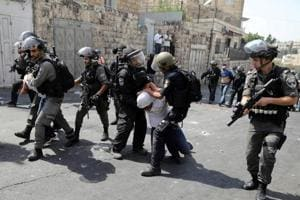 Israel arrests 51 Palestinian protesters in east Jerusalem raid
