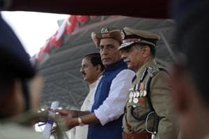(From left)Union culture minister Mahesh Sharma, Union home minister Rajnath Singh and ITBP director general RK Pachnanda at the 56th Raising Day of the ITBP in Greater Noida on Tuesday.