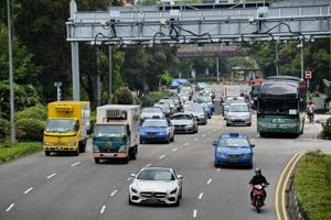 Singapore to freeze number of cars on its roads, expand public...