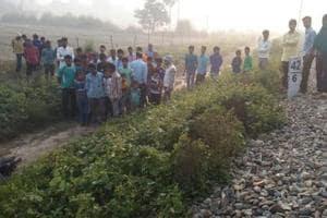 People gather near the railway track in Maigalganj where Afrin Khatoon's body was found on Wednesday.