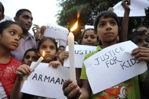 Students accompany their parents during candlelight protest to call for action in the Ryan murder case. The September incident brought safety of students in schools into sharp focus.