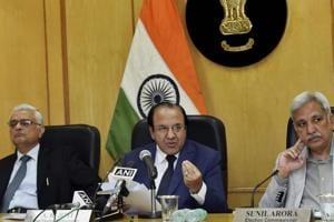 Members of the election commission announce the date for the Himachal polls on October 12.