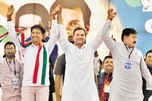Congress vice president Rahul Gandhi (centre) at an election rally, Gandhinagar, Gujarat, October 23. OBC leader Alpesh Thakor (left) joined the party in Gandhi's presence