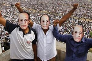 Patidars or members of Patel community wear masks of Sardar Vallabhbhai Patel as they participate in a rally in Ahmedabad.