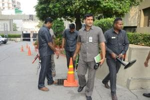 Security officials outside the Indian and New Zealand teams hotel in Kanpur on Thursday.