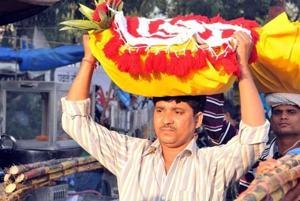 File picture of a devotee carrying fruits and sweets to perform Chhath puja.