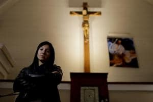 In this Oct. 11, 2017 photo, Yasmin Detez poses for a portrait inside San Jose Obrero church where Rev. Carlos Jose celebrated Mass in Caseros, in the province of Buenos Aires, Argentina.