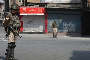 Paramilitary forces stand guard in Srinagar during a shutdown earlier in October.